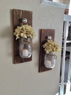 Set of mason jar sconces a perfect addition to your rustic wall decor. The jars are frosted and tied and hung with twine. They include two LED flickering candles. There are several different sconce finishes to choose from just scroll through the pics to see your options and select at checkout.  I ship priority with tracking and insurance included! :)
