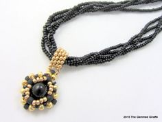 The Multi Strand Black Obsidian Pendant Necklace is an elegant piece of jewelry that should be worn with your date night or evening out wear.  @thegemmedgiraff