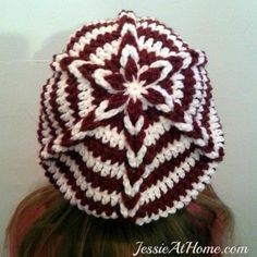 The Delia Slouch Hat is the sister hat to the Delia beanie hat. This free crochet pattern features a Jacob's Ladder detail up the hat, and a starburst top.