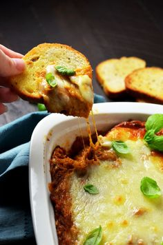 Eggplant Parmesan Dip. This warm, cheesy dip is loaded up with tomato sauce, garlic, and roasted eggplant. I love making it for winter parties. | hostthetoast.com