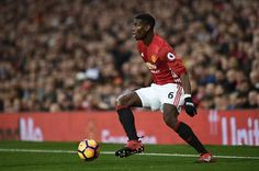 Manchester United's French midfielder Paul Pogba controls the ball during the English Premier League football match between Manchester United and...