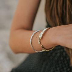 Sleek and elegant on their own or when stacked, our beautiful bangles draw inspiration from natural forms and are handcrafted in recycled sterling silver and 18ct gold vermeil and all our bangles can be personalised. #silverbracelet #surferstyle #summerstyling #goldbracelet #classicgold #silverbangle Surfer Style, Classic Gold, Natural Forms, Dainty Jewelry, Silver Bangles, Personalized Jewelry, Handcrafted Jewelry, Draw, London