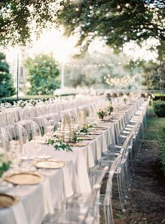 FOR THE RECEPTION || Garden dining with long white tables & ghost chairs by Lauren Peele Photography || NOVELA BRIDE...where the modern romantics play & plan the most stylish weddings...www.novelabride.com @novelabride #jointheclique