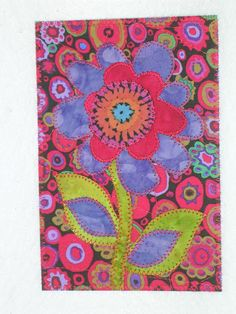 Whimsical Flower Bright Colors Quilted Appliqued Fabric Postcard. $6.00, via Etsy.