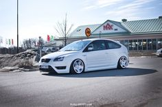 White, low Ford Focus ST mk2