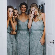 Take a photo of the bridesmaids reactions to the bride in her dress!!