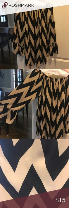 Flowy Chevron Top black and tan gorgeous chevron print! This is a super cute flowy top that could be worn with jeans or leggings. This top could be easily dressed up for a night out as well. Tops