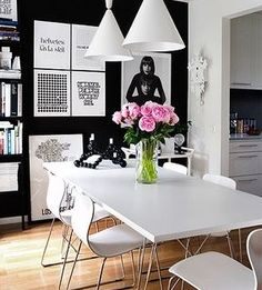 Black wall, white accents and love the addition of the pink flowers. REAL POP