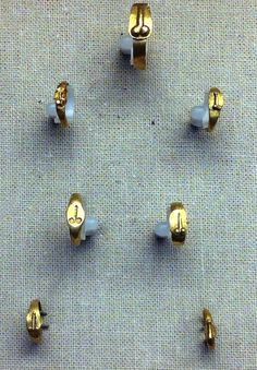 Tiny gold phallic rings (for children) to keep away evil. British Museum.