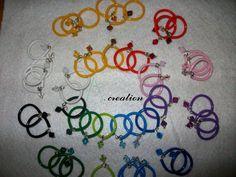 anelli realizzati con base in metallo e plastica e cristallo swarovski