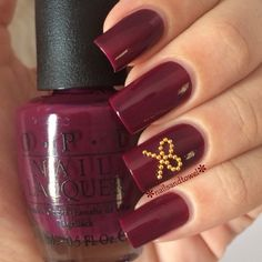 violet-red wine nails one of my favorite colors, with a gold bow accent, super cute <3