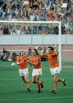 The Netherlands' Johan Cruyff celebrates with teammates Wim Jansen and Johnny Rep after a goal against Uruguay during their Group C World Cup match on June 1974 at. God Of Football, Football Design, National Football Teams, World Football, Football Soccer, Pure Football, Team Goals, English Football League, World Cup Match