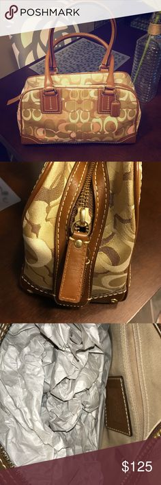 Medium Size Coach Bag Medium sized brown Coach bag in new condition. Original paper still in the bag! Coach Bags Totes