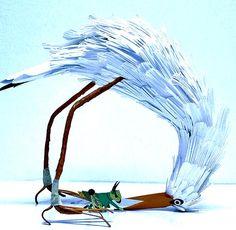 paper-crafted sculptures by Colombian artist Diana Beltran Herrera .
