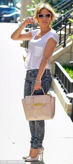 Jennifer Lopez parades her shapely bottom in skinny snakeskin jeans #dailymail