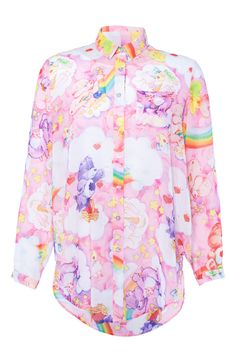 Care Bears and rainbows make up the cute all over pattern on this stylish oversize blouse in the softest poly chiffon...