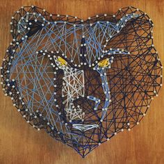 Handmade string art on 12x16 wood of the Memphis Grizzlies logo.