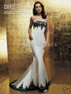 White wedding dress with black lace Not that I'm getting married, but such a stunning dress!
