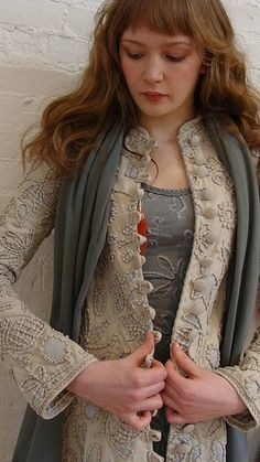 I like the idea of all these button loops done in felt.   Specialty-stitched coat from Alabama Chanin