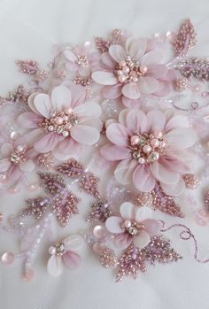 Sewing Fabric Flowers Hand-made motif with pearls, twinkling balls of glass beads and petals wrapped in silk organza - Couture Embroidery, Silk Ribbon Embroidery, Hand Embroidery, Embroidery Designs, Embroidered Lace, Embroidery Stitches, Chiffon Flowers, Fabric Flowers, Material Flowers