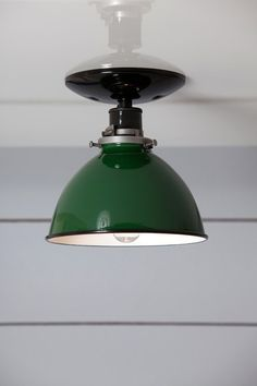 This Custom Made to Order Green Metal Shade Ceiling Mount Light comes with  -Black or White Ceramic Socket (250V Max) -Black or White Ceiling Canopy -Green Metal Shade -UL Listed  Dimensions- Overall Size- About 7in Tall X 7in Wide Ceiling Canopy- 5in Wide with Universal Mount  Rated for 60 Watts Max.  Electrical Lead wires and Socket will work anywhere in the world.  Bulbs are 120 Volts, Standard US / Canada Voltage (Bulbs can not be shipped outside the US / Canada)  Also availabl...