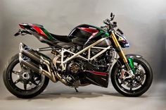 "This bike was modified in 2010 by Motovation Accessories out of Austin, Texas. It started out as a stock black Streetfighter S that was purchased from Ducati Austin and it didn't stay that way for long. Roland Lee of Motovation said that:""The moment we saw the Streetfighter we realized it was a great canvas to …"