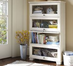 Kent Bookcase #potterybarn would love this for the home. To keep little hands from pulling the books off the shelf.