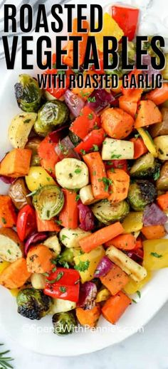 Roasted Vegetables are the perfect fall staple! A mixture of our favorite vegetables with a combination of colors and textures are roasted until golden and caramelized. The veggies are tossed with tender roasted garlic cloves and a get a creamy flavor boost from an easy hummus vinaigrette. #spendwithpennies #roastedvegetables #withsmashedgarlic #roastedgarlic #rootvegetables #easysidedish #easyrecipe #ovenroastedvegetables #autumnrecipe