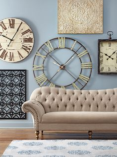 The ultimate gallery wall has large clocks and plaques. Absolutely gorgeous. HomeDecorators.com