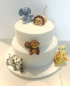 A simple zoo animal baby shower cake