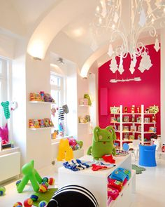Hot Pink and colorful toys make a white room look FANTASTIC