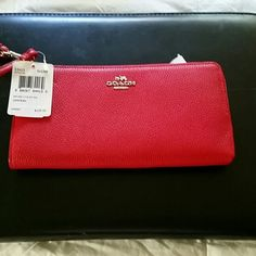 Coach Leather Zip Wallet Brand new with tags.....True Red Leather Zip wallet..has divider and 8 pocets for credit cards on one side plus two long pockets for ur phone and maybe checkbook on the other.Also has a back zipper pocket on the outside where the hardware still has the original soft cover attached so it wont get scratched...Never Used..silver hardware Serial number F1583-S3413 Coach Bags Wallets