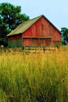 faded Red Barn Beside The Field
