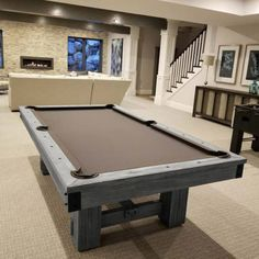 The Silverton rustic wood pool table is incredibly sturdy and comes with metal accents on the corners and stretchers. The Silverton is manufactured out of African Mahogany wood, and the table is built to withstand the demands of an active family. Basement Family Rooms, Game Room Basement, Basement Ceilings, Basement Bars, Playroom, Pool Table Dining Table, Pool Table Room, Basement Bar Designs, Home Bar Designs