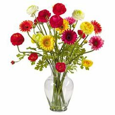 "Silk ranunculus and gerbera daisy arrangement in a glass vase.   Product: Faux floral arrangementConstruction Material: Silk and glassColor: MultiFeatures: Includes faux ranunculus and gerbera daisiesDimensions: 24"" H x 24"" W x 21"" D"
