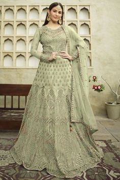 Cast a spell with this pistachio green net anarkali suit which will give you absolute perfection. This round neck and full sleeve costume designed using zari and stone work. Accompanied by a matching satin churidar in pistachio green color with pistachio green net dupatta. Churidar is plain. #anarkalisuit #usa #Indianwear #Indiandresses #andaazfashion Costumes Anarkali, Anarkali Gown, Anarkali Suits, Indian Salwar Kameez, Churidar, Angrakha Style, Floor Length Anarkali, Gowns Online, Traditional Looks