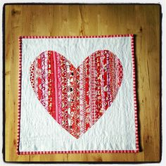 """Heart mini-quilt/wall-hanging (Sew 1"""" wide strips together, cut out heart shape, applique onto square white background fabric.)"""