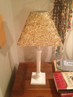 I want to do this with a coral painted base to accent Shays room redo!! Via~oh, pish posh: Gold Sequin Lamp Shade.