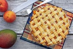 """Peach mango pie is a dessert made out of baked flaky pastry filled with mangoes and peaches, a dessert popularized by a Filipino fast food chain called """"Jollibee"""" as an answer to McDonalds """"apple pie"""". Mango Recipes, Pie Recipes, Sweet Recipes, Dessert Recipes, Cooking Recipes, Dessert Ideas, Delicious Recipes, Snack Recipes, Recipes"""