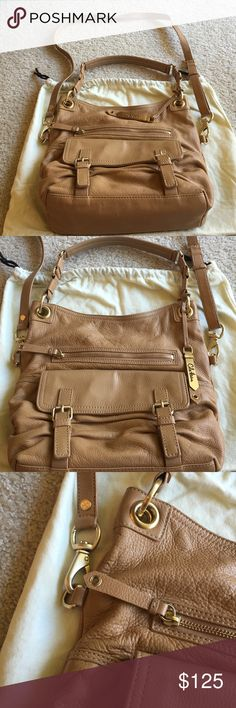 Cole Haan Cross Body Handbag Cole Haan Crosby body bag with detachable strap for wearing on the shoulder alone. Zippered front and separate close over pockets. Very functional, easy to carry style. Like new condition! Cole Haan Bags Crossbody Bags