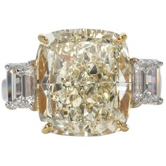 Fancy Yellow 10.06 Carat Cushion Cut Diamond Ring | From a unique collection of vintage engagement rings at https://www.1stdibs.com/jewelry/rings/engagement-rings/
