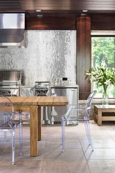 Super glam kitchen. Don't know that I could handle this daily, but super gorg. Second home kitchen idea maybe...