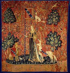 La Dame à la licorne .La Richesse=le Toucher Le style serait celui du Maître d'Anne de Bretagne, un enlumineur et graveur qui travaillait pour la commanditaire de la Chasse à la licorne, Anne de Bretagne, soit Jean d'Ypres, mort en 1508, ou son frère Louis. Tous les deux sont issus d'une lignée de peintres qui aurait inspiré les cartons des tapisseries