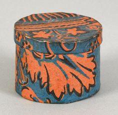 Small Pennsylvania wallpaper box, mid 19th c., having an orange foliate decoration on a blue ground, 2 1/2'' h., 3 1/4'' w.