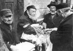 Warsaw, Poland, A Jew selling prayer shawls in the ghetto. Warsaw Ghetto Uprising, Florence Nightingale, Evil People, Warsaw Poland, Lest We Forget, Anne Frank, Male Figure, Persecution, World War Two