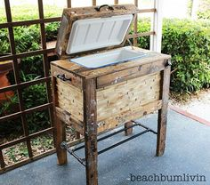 rustic cooler made from pallets - there is even a bottle opener on the front!