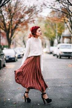 chunky sweater and satin pleated skirt