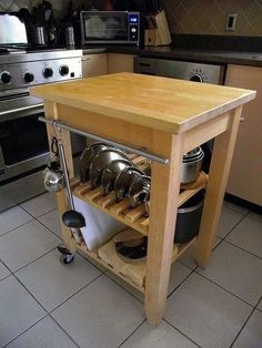 Ikea Bekvam cart - cookware storage with clever use of cabinet handle as rail for hanging items & slats to hold lids in place Ikea Trolley, Kitchen Storage Trolley, Kitchen Island Cart, Kitchen Islands, Ikea Storage Cart, Pan Storage, Extra Storage, Storage Ideas, Ikea Bekvam
