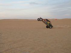 iStock - BUY ME! - Dune Buggy Popping a Wheelie in Glamis stock photo