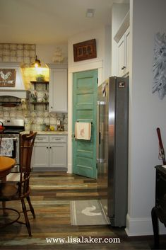 Eclectic farmhouse kitchen, teal pantry door, vintage style flooring, eclectic flooring, patterned backsplash tile, open shelving kitchen, kitchen antique decorating, mixing painted and stained cabinetry